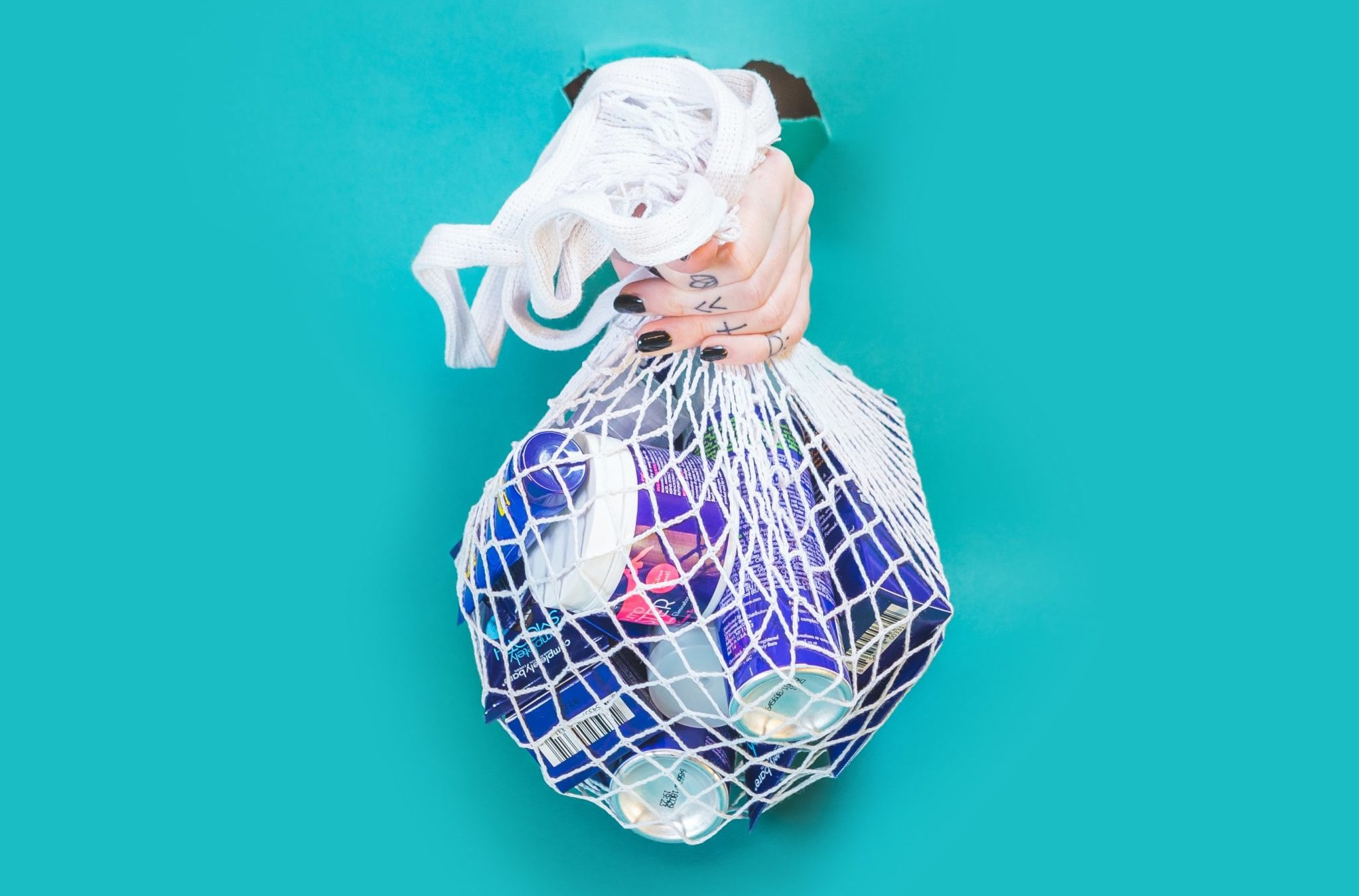 hand holding a bag full of plastic products