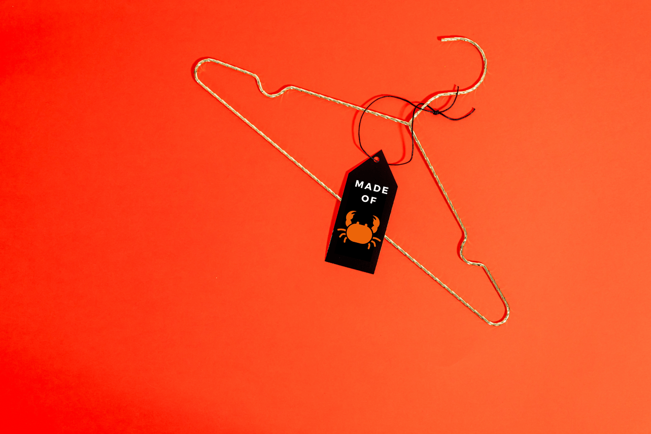 clothes hanger with crab printed tag